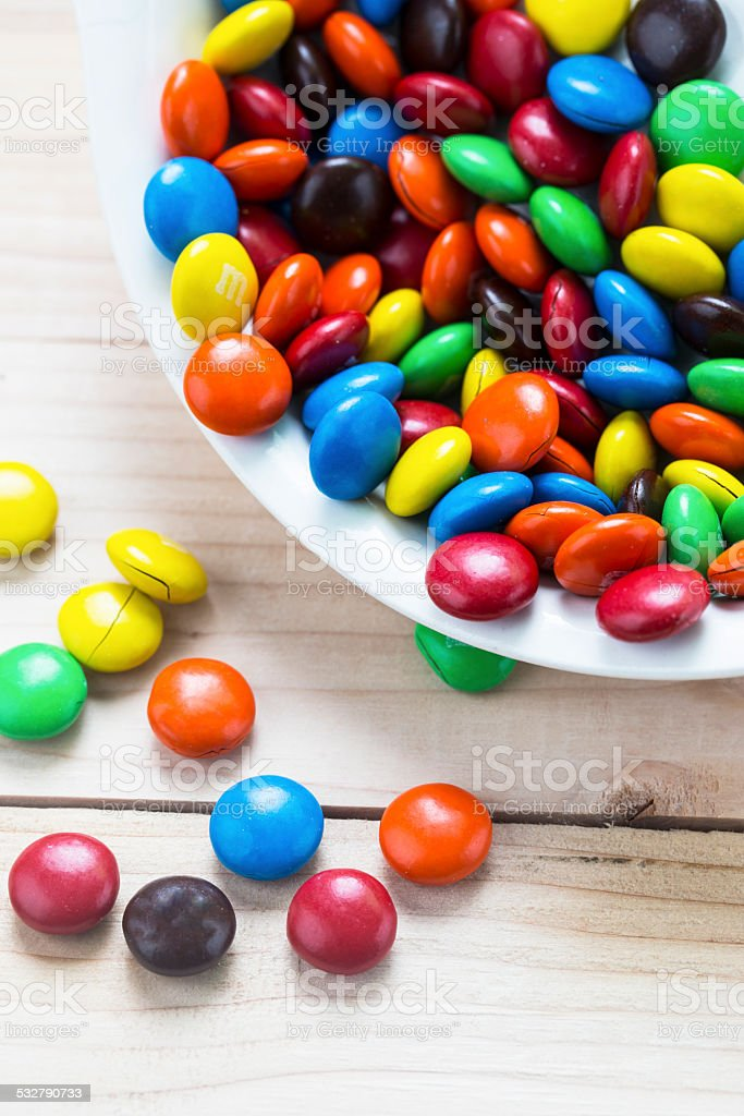 Close up of a pile of colorful chocolate coated candy stock photo