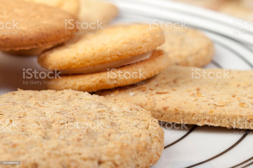 Close up of a plate of assorted fresh crisp biscuits stock photo