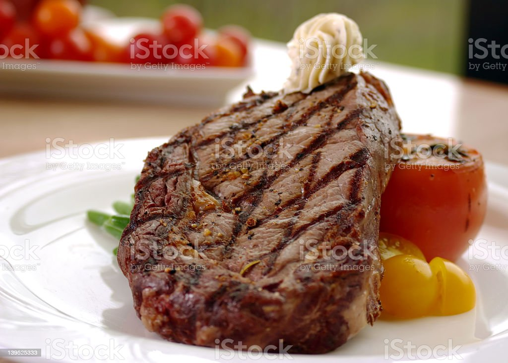 Close up of a prepared rib eye steak for dinner stock photo
