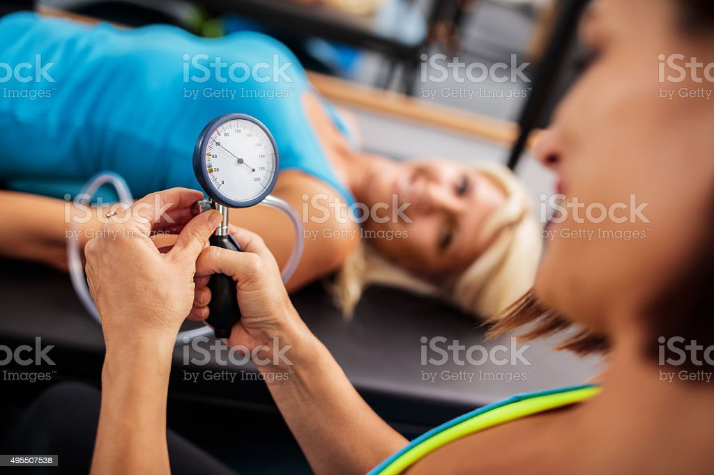 Close up of a pressure gauge in woman's hands. stock photo
