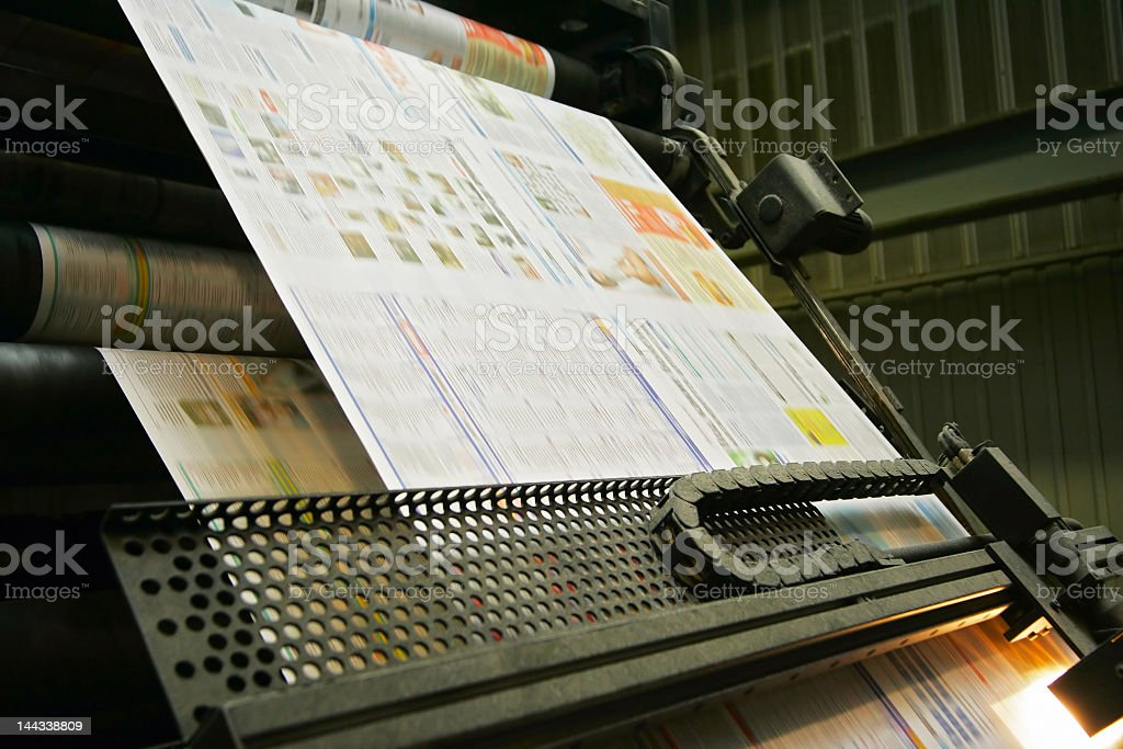 Close up of a printing press loaded with paper royalty-free stock photo