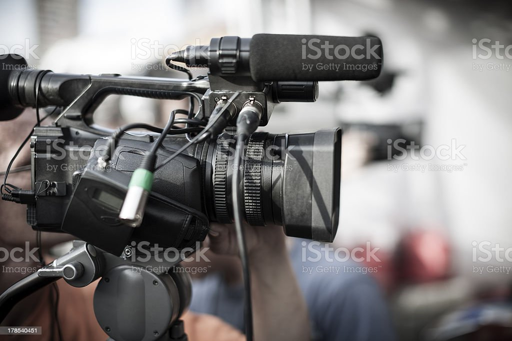 Close up of a professional camera at a news shooting stock photo