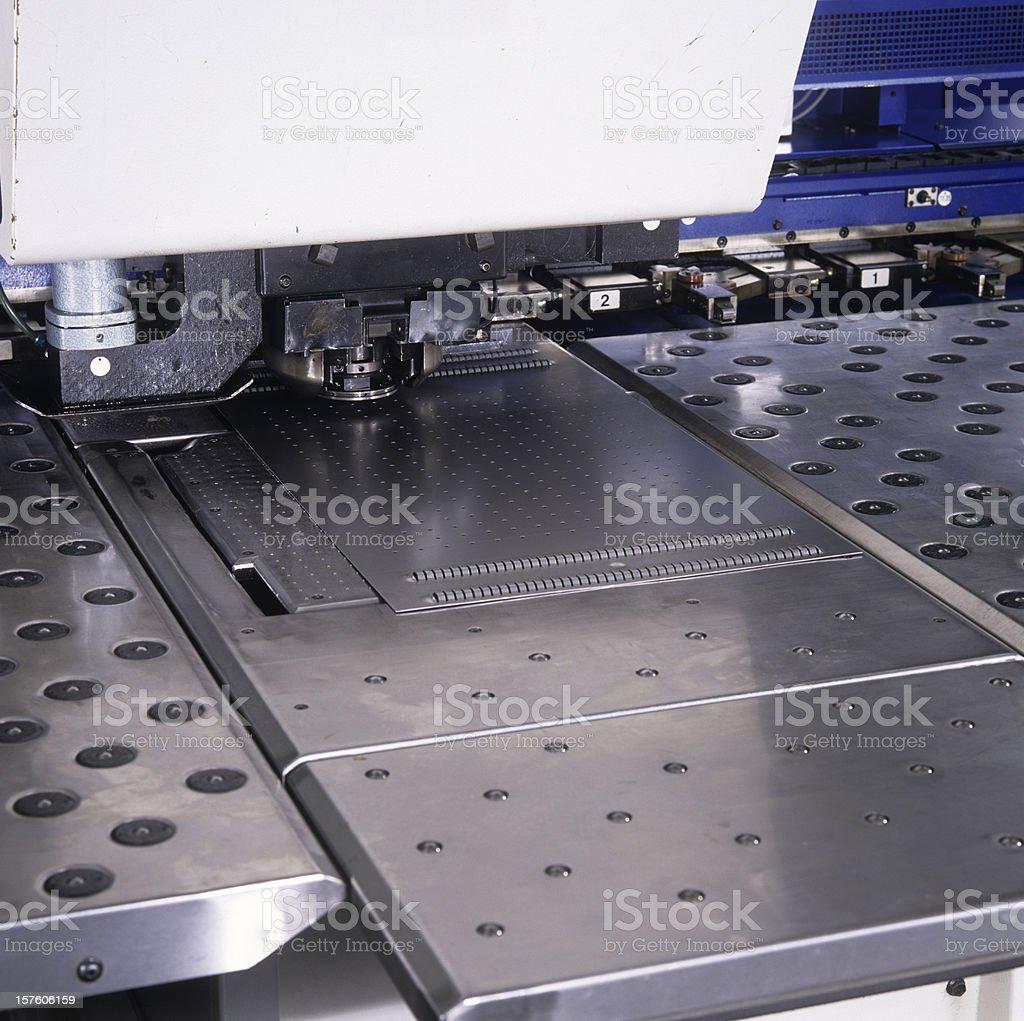 Close up of a punching machine stock photo