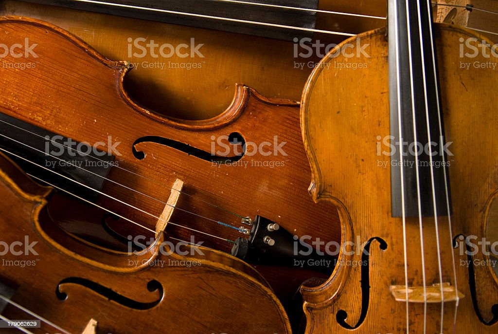 Close up of a quartet of violins royalty-free stock photo