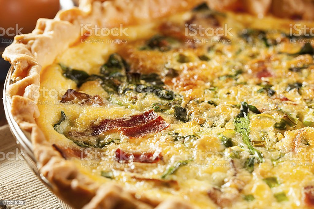 Close up of a quiche made from spinach, egg and bacon stock photo