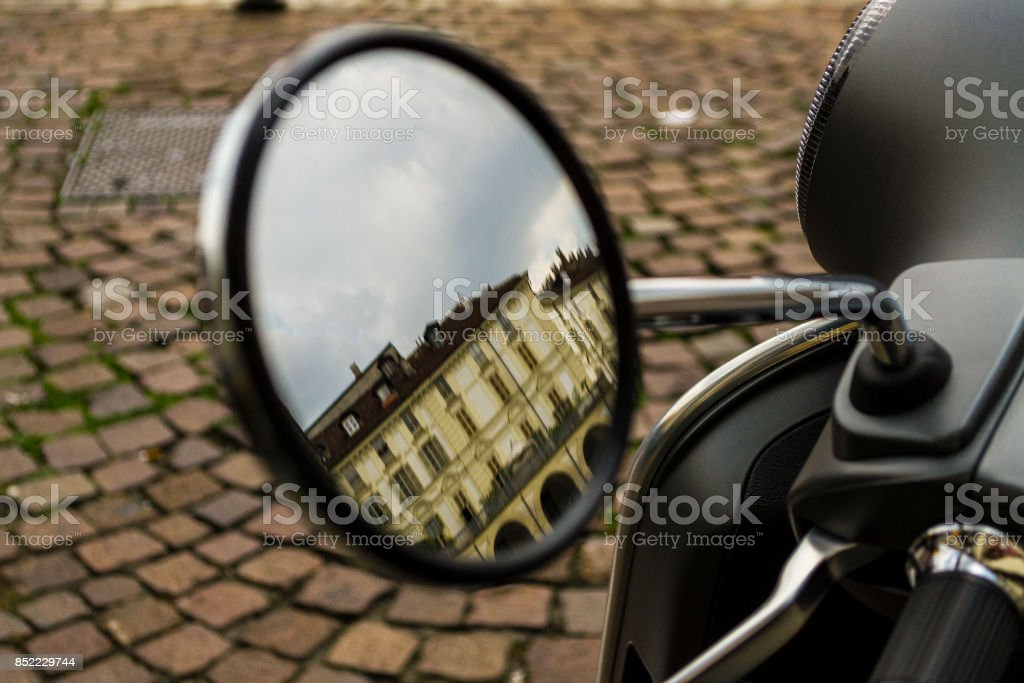 Close up of a rear view mirror in Turin (Piedmont, Italy) stock photo