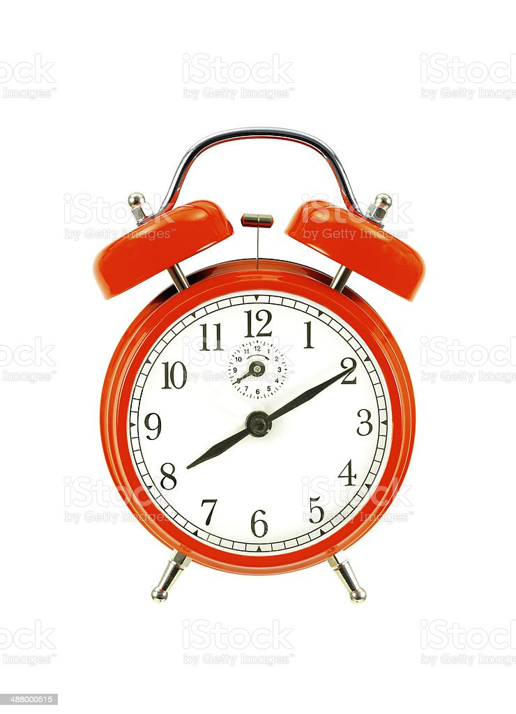 close up of a red bell clock (alarm clock) isolated royalty-free stock photo