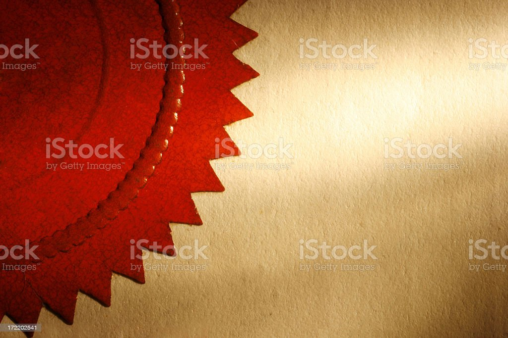 Close up of a red seal on a piece of yellowed paper stock photo