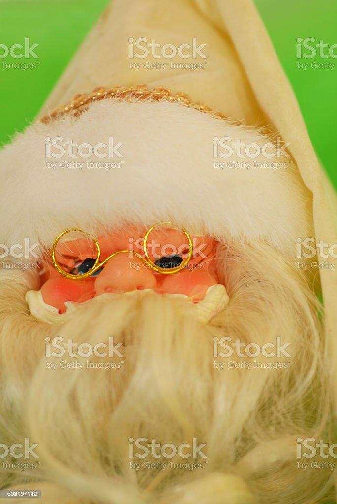 Close up of a Santa face warring glasses. stock photo