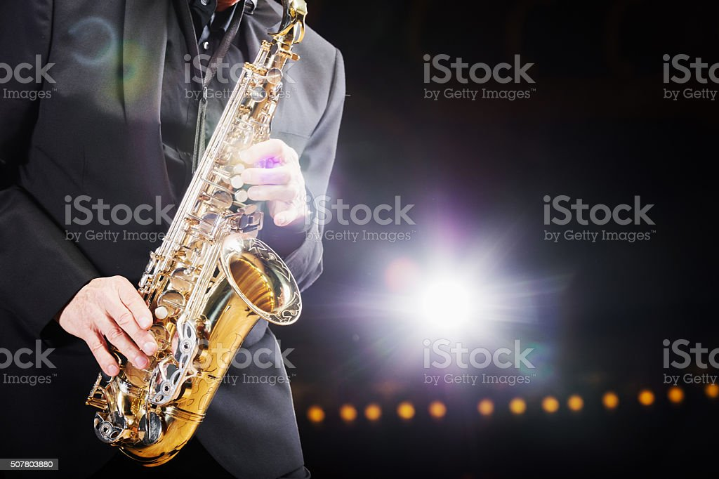 Close up of a saxophone player with backlight stock photo