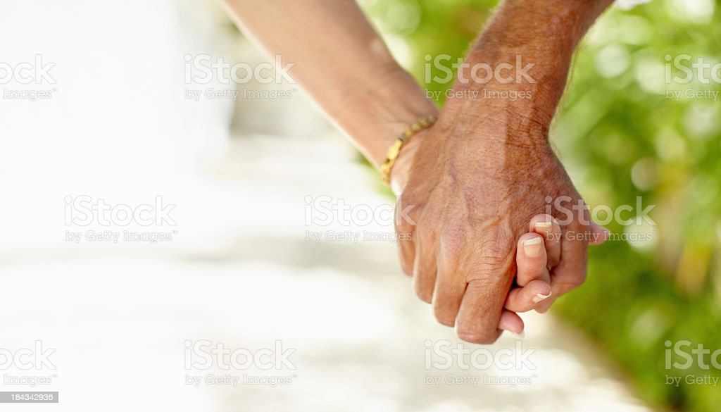 Close up of a senior couple holding hands royalty-free stock photo