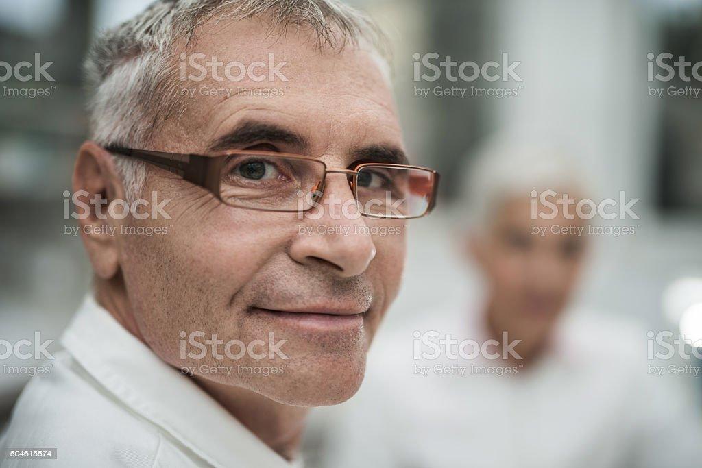 Close up of a senior man looking at the camera. stock photo
