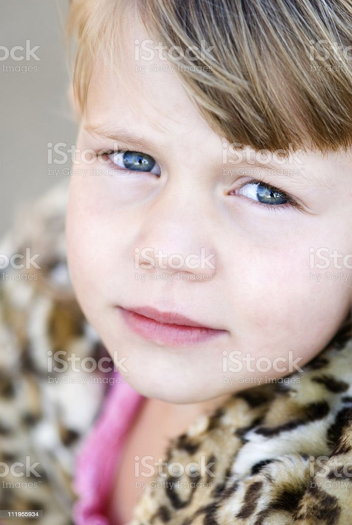 Close up of a serious little blond girl's face royalty-free stock photo