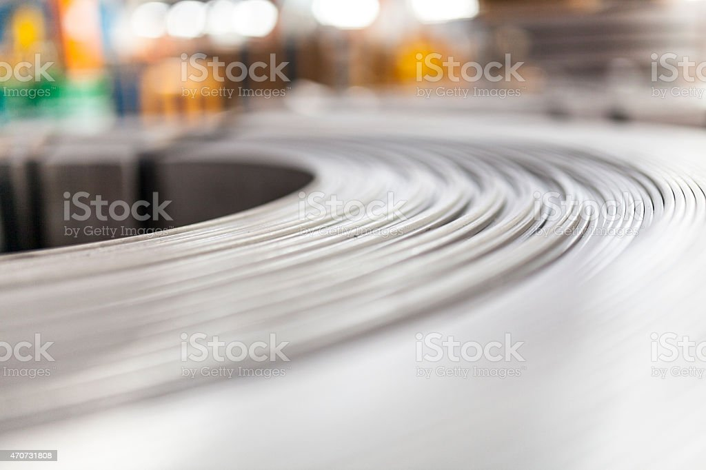 Close up of a silver roll of steel sheet stock photo