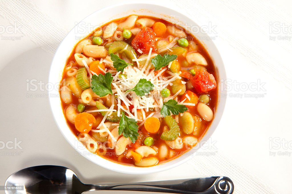 A close up of a single bowl of minestrone soup stock photo