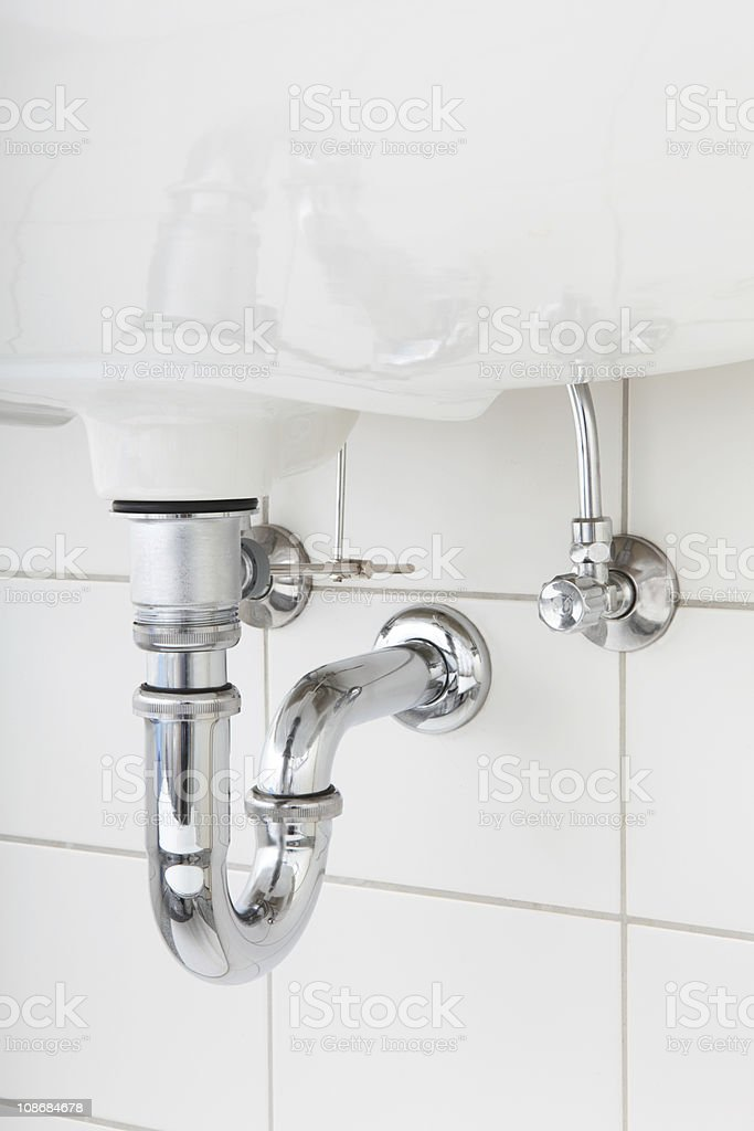 Close up of a sink pipe under a washbasin stock photo