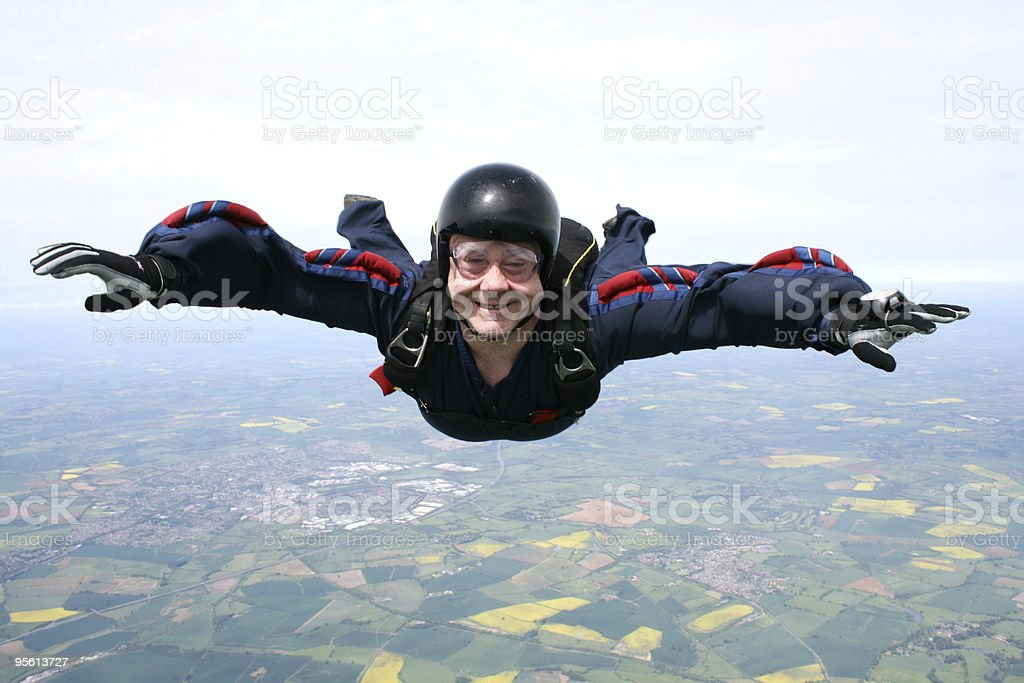 Close up of a skydiver in freefall royalty-free stock photo