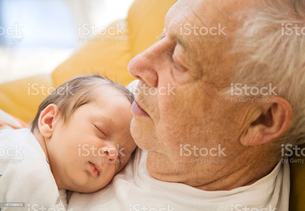 Close up of a sleeping grandfather and grandson  royalty-free stock photo