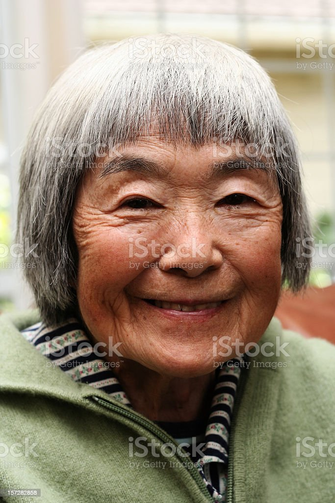 A close up of a smiling elderly woman stock photo