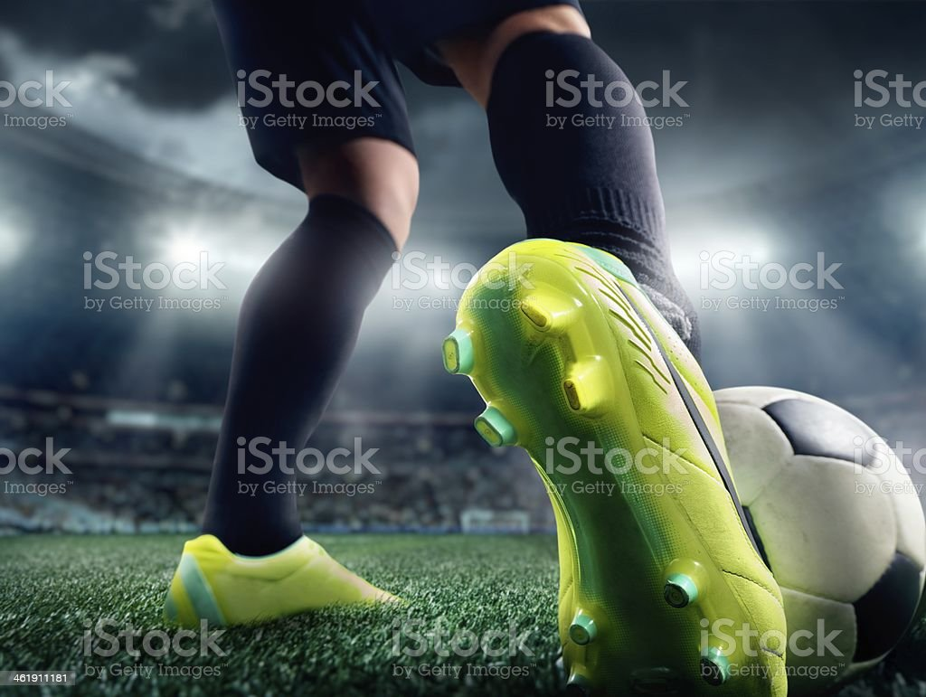 Close up of a soccer player's foot in a stadium royalty-free stock photo