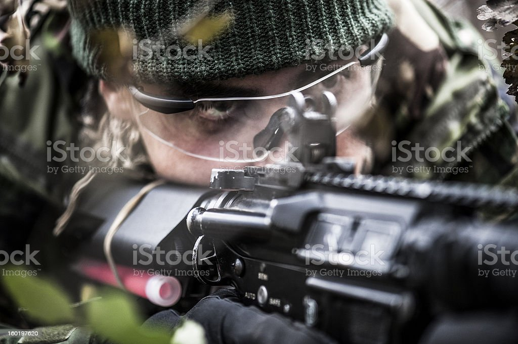 Close up of a soldier aiming stock photo