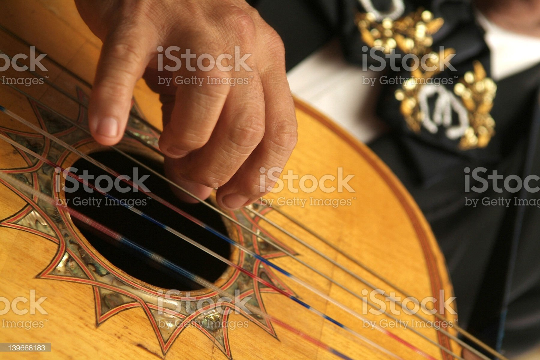 Close up of a Spanish guitar being played by a hand royalty-free stock photo