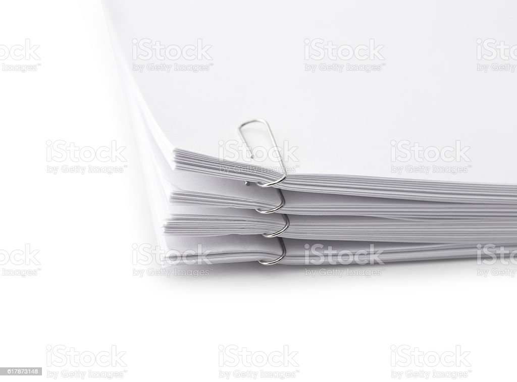 Close up of a stack of papers and paper clip stock photo