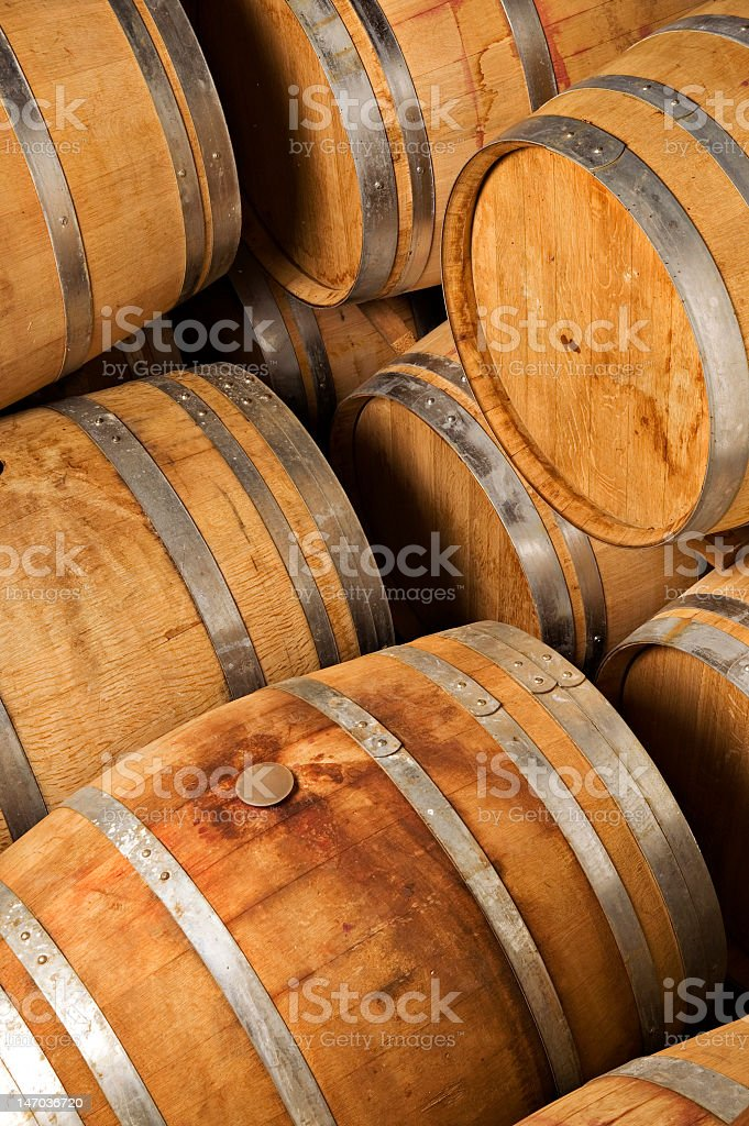 Close up of a stack of wine barrels royalty-free stock photo