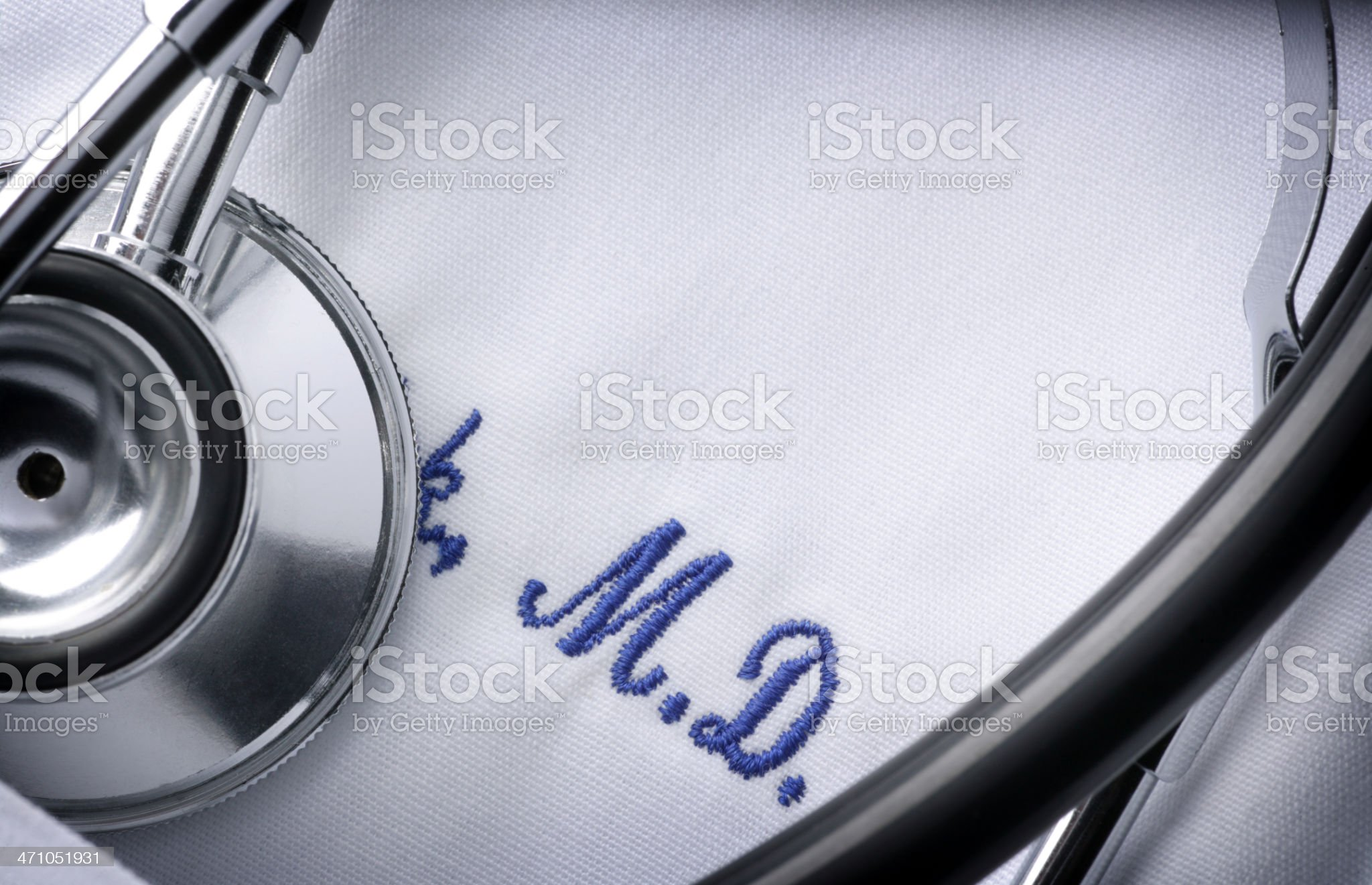 Close up of a stethoscope and embroidery on a doctor's jacket royalty-free stock photo