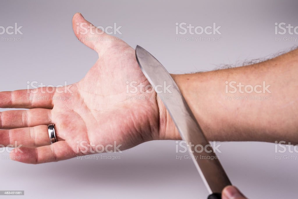 Close up of a suicidal man hand on isolated stock photo