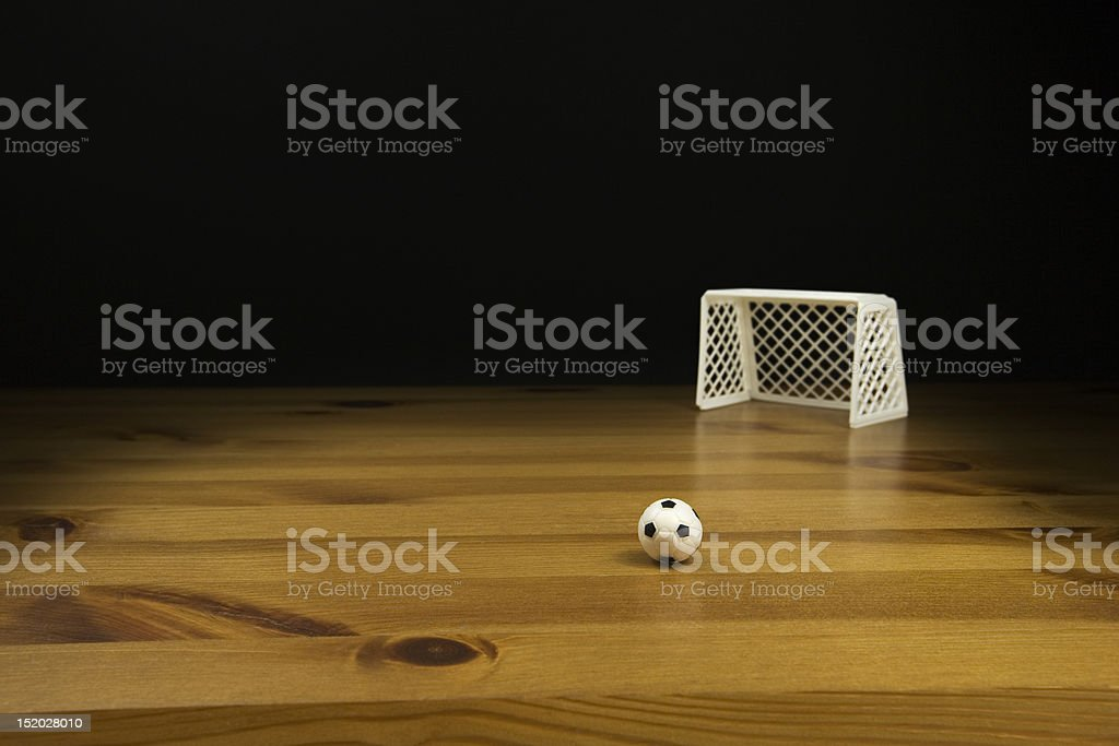 Close up of a Table Top fotball and Goal post on a stock photo