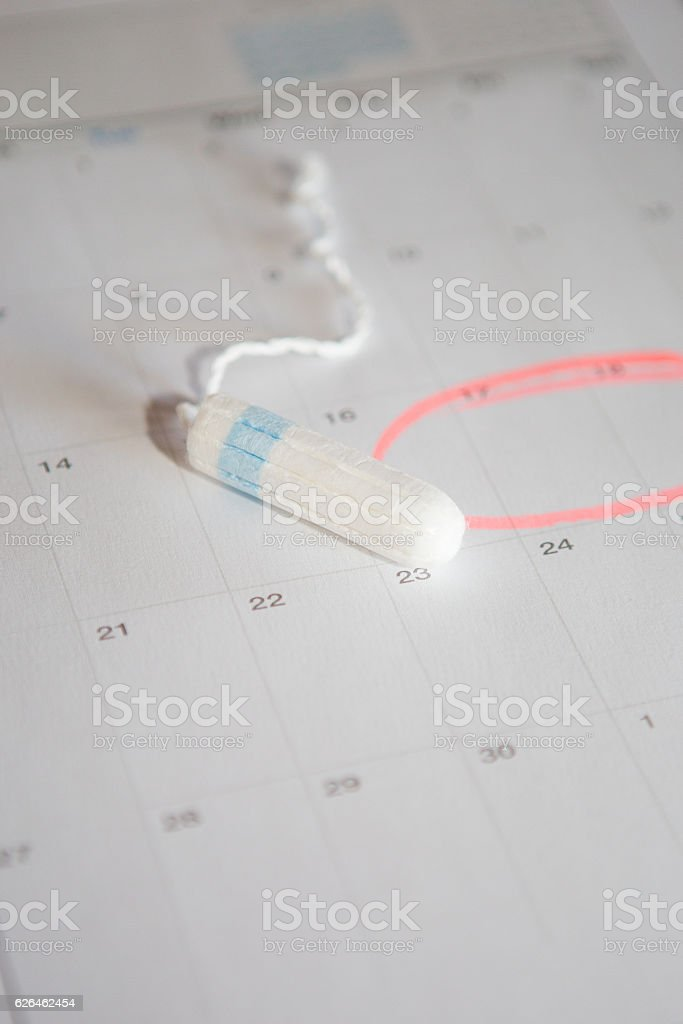 Close up of a tampon and a calendar stock photo