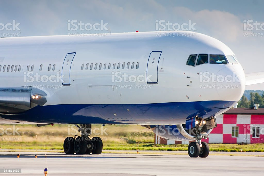 Close up of a taxiing commercial airliner royalty-free stock photo