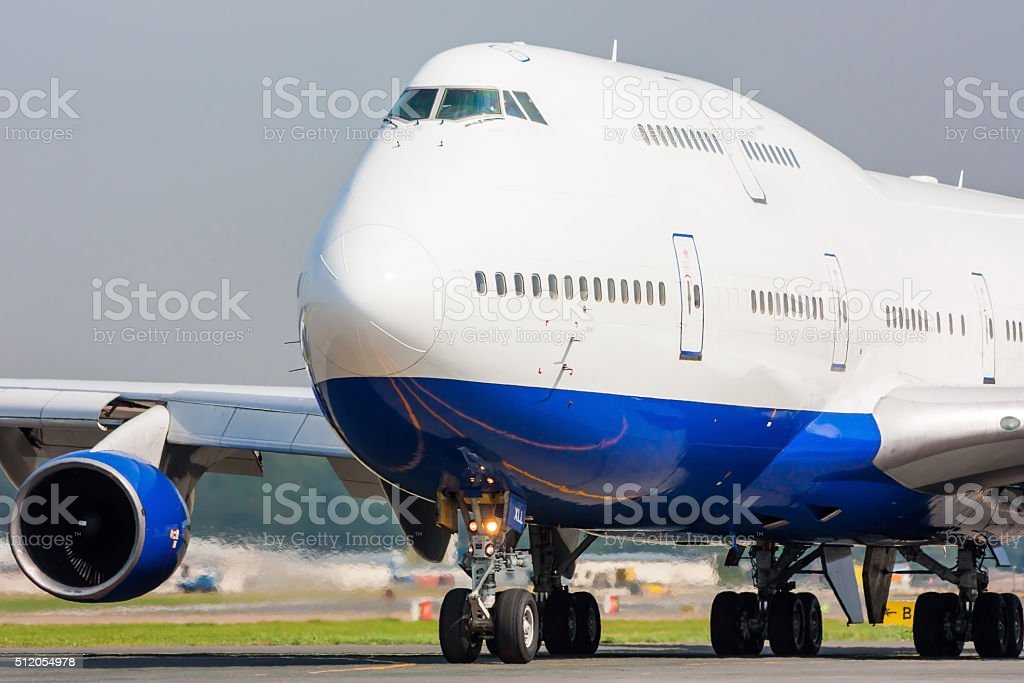 Close up of a taxiing commercial Jumbo Jet royalty-free stock photo