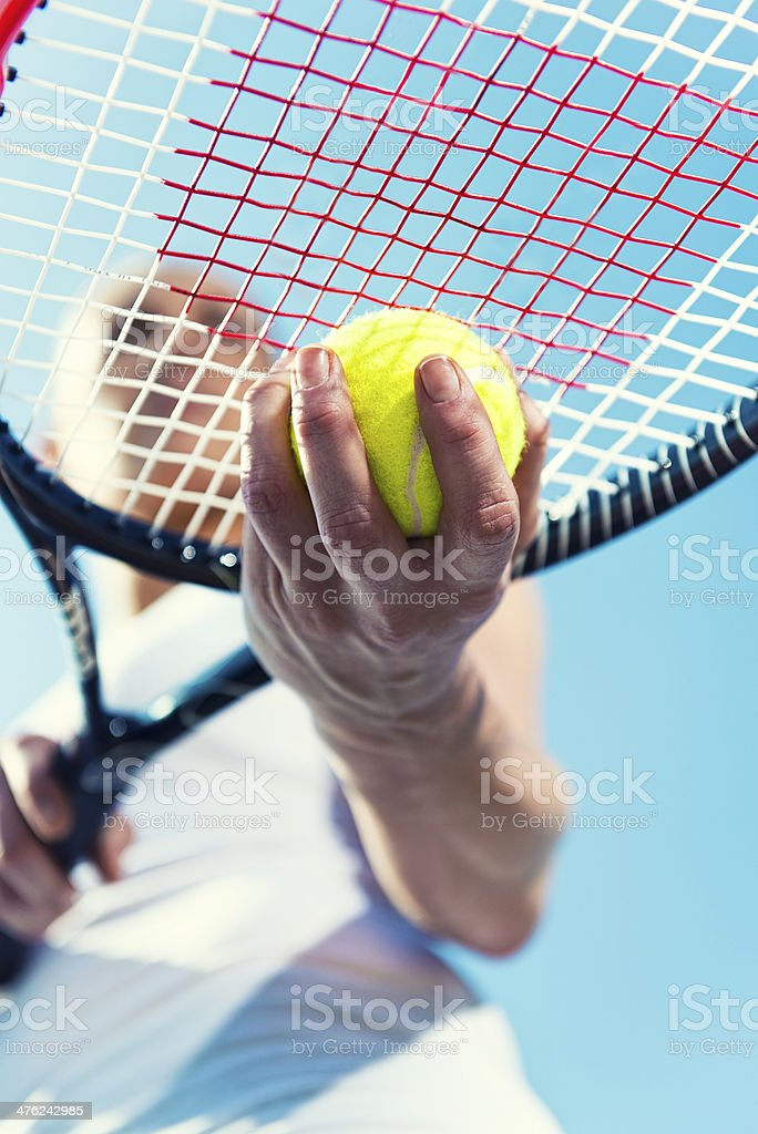 Close up of a tennis ball and racket royalty-free stock photo
