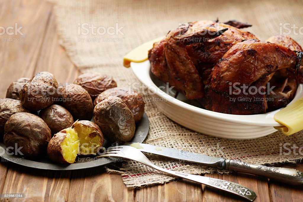 close up of a tray of rustic roasted baked potato stock photo