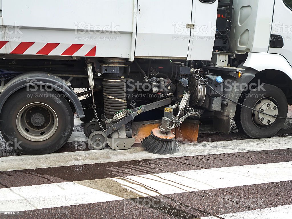Close up of a truck cleaning a street stock photo