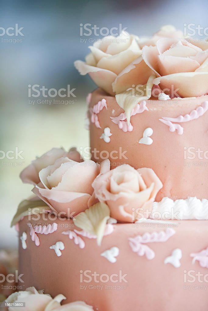 Close up of a two tiered pink iced wedding cake stock photo