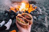 Close up of a vegetarian sandwich near campfire