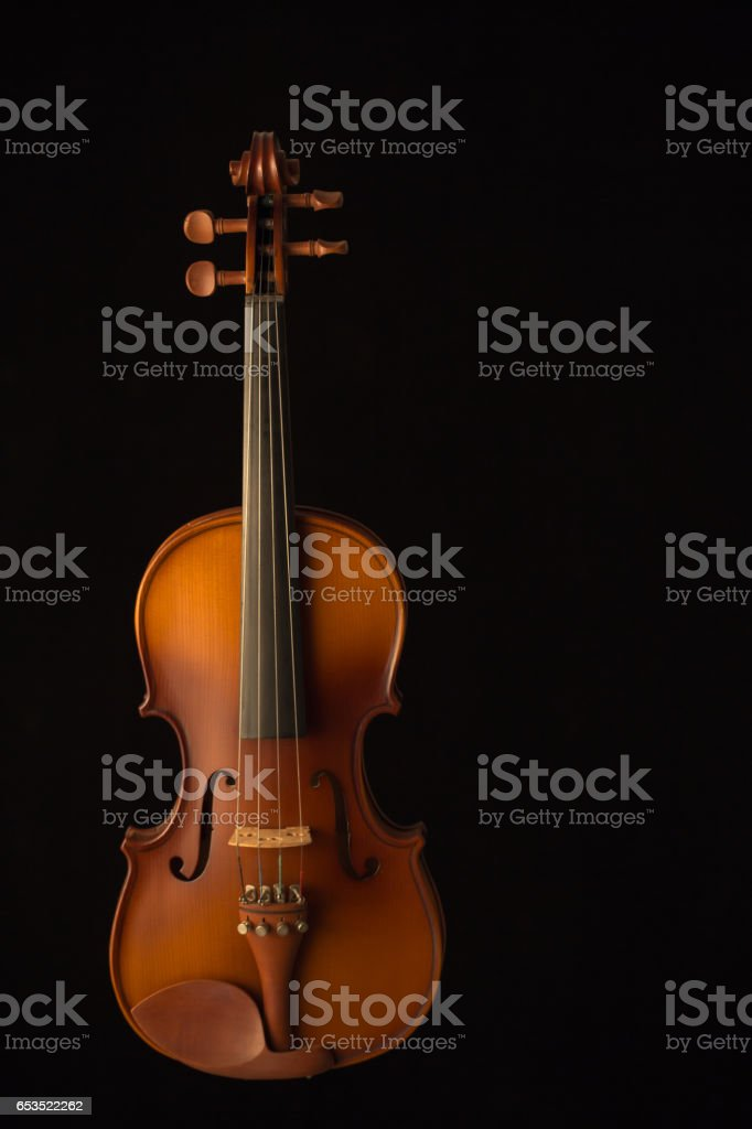 Close up of a violin isolated on a black background stock photo