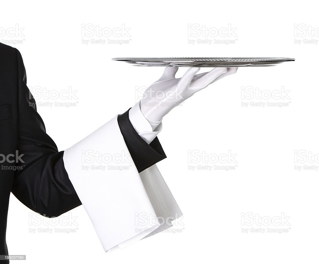 Close up of a waiter holding silver tray royalty-free stock photo