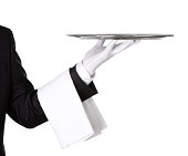 Close up of a waiter holding silver tray