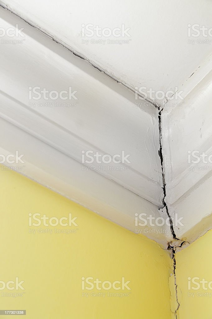 Close up of a wall crack at the corner of ceiling royalty-free stock photo