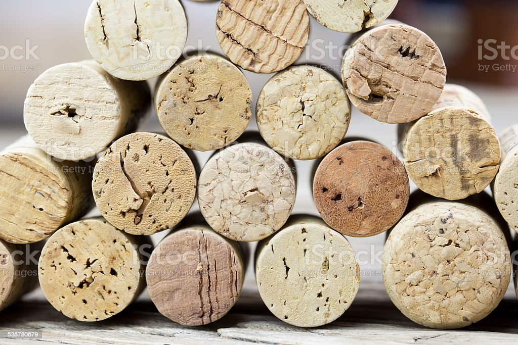 Close up of a wall of used cork wine stock photo