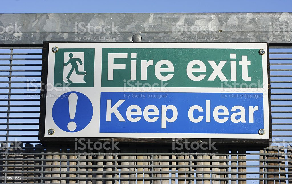 Fire exit keep clear words on safety signs outdoors stock photo
