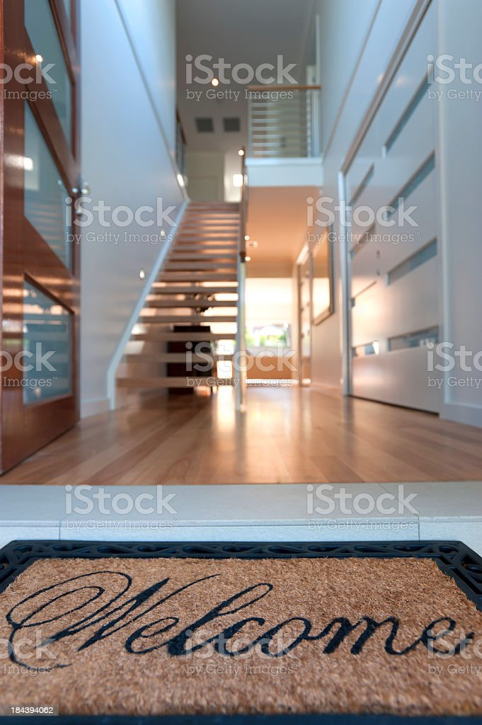 Close up of a welcome mat in inviting house stock photo