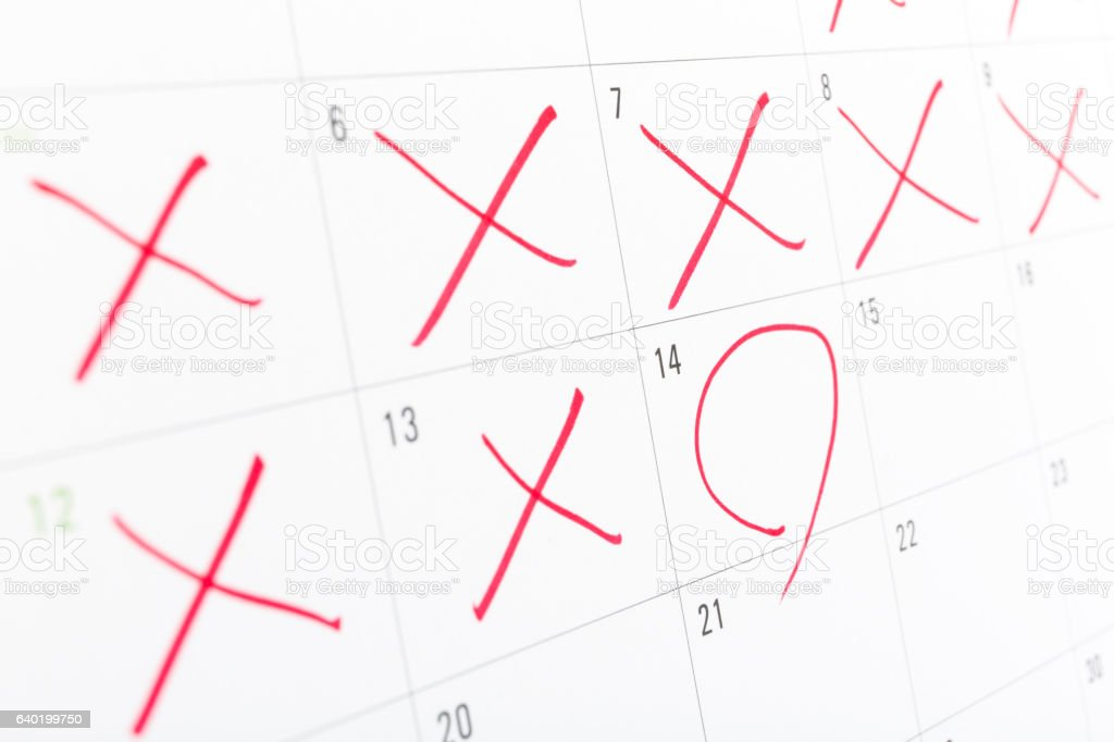 close up of a white calendar page with some  th stock photo