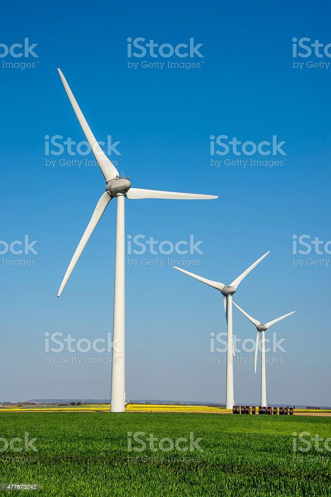 Close up of a wind turbine view from below stock photo