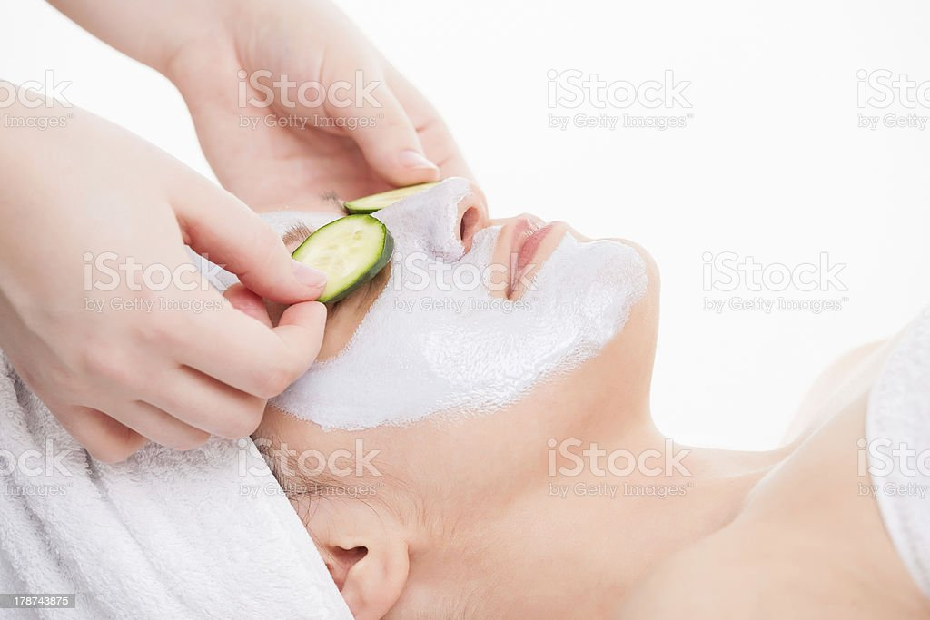 Close up of a woman getting facial mask treatment royalty-free stock photo