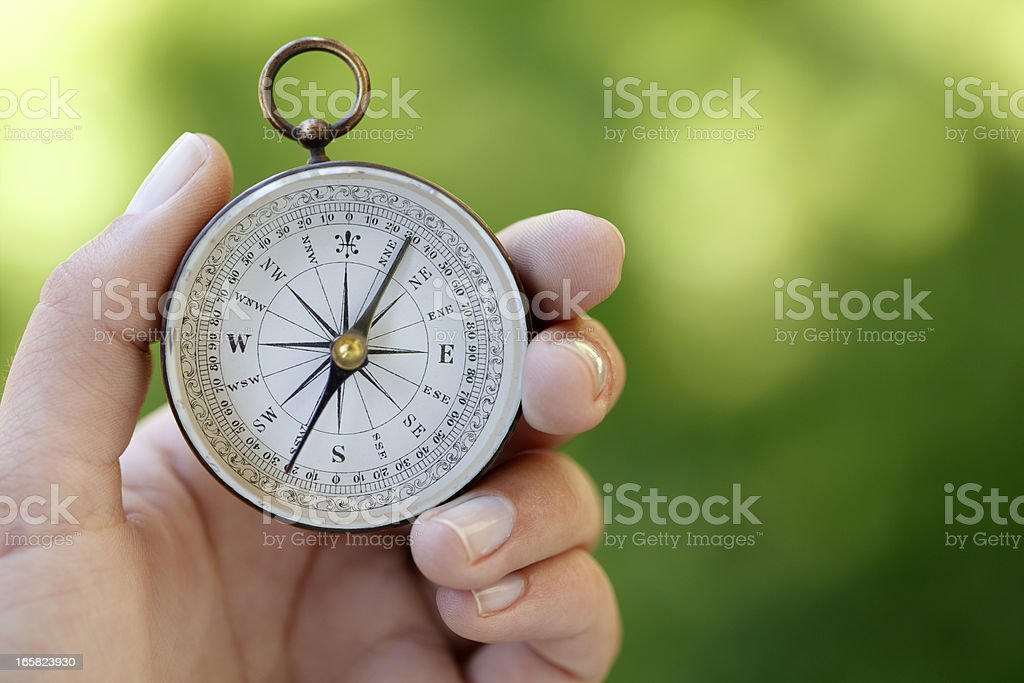 Close Up Of A Woman Holding A Compass royalty-free stock photo